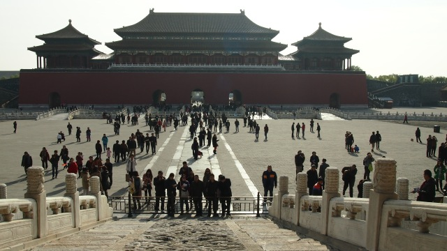 Standing at the Gate of Supreme Harmony, looking towards the awesome Meridian Gate, the Forbidden City is invaded by tourists.