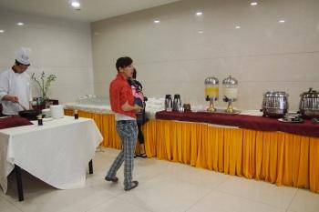 China hotel buffet line with HOT orange juice.