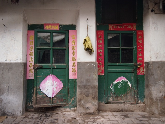 Behind closed doors in a Pingyao lane.