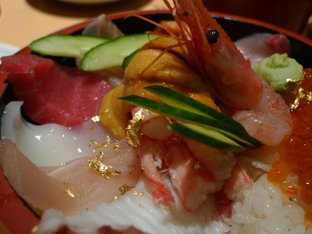 gold leaf flakes in our Chirashi sushi bowl at dinner in Nishiki market.